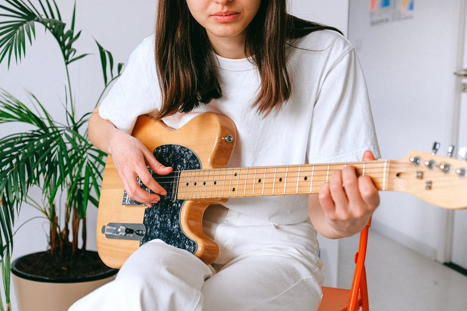 A person holding a guitar